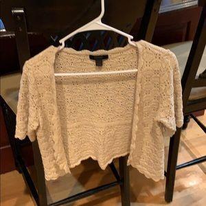 Women's cropped sweater.